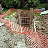 Creating culvert for stream diversion under road. A4251 Hemel Hempstead to Berkhamsted road refurbishment scheme, United Kingdom.