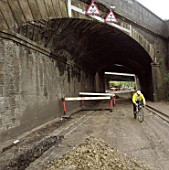 Road about to be resurfaced under railway overbridge. A4251 Hemel Hempstead to Berkhamsted road refurbishment scheme, Hertfordshire, United Kingdom.