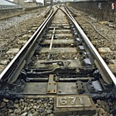 Detail of points on railway line electrified using third rail system.