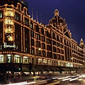 Illuminated facade of Harrods. Knightsbridge, London, United Kingdom.