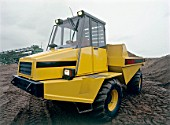 Small Thwaites dumper on construction site.