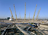 Construction of North Greenwich transport interchange, alongside the Millennium Dome. London, United Kingdom. Dome designed by Richard Rogers Partnership.