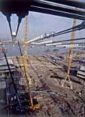 Construction of the roof canopy at the Millennium Dome. London, United Kingdom. Dome designed by Richard Rogers Partnership.
