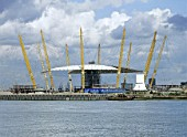 Construction of the roof canopy  at the Millennium Dome. London, United Kingdom. Designed by Richard Rogers Partnership.