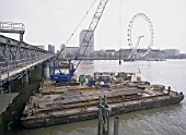 Barges during construction of new Hungerford footbridge. London, United Kingdom.
