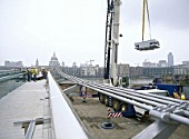 Retro-fitting damping to Millennium Bridge using Baldwins Liebherr mobile crane. London, United Kingdom. Bridge designed by Norman Foster and Partners.