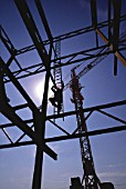 Workman accessing steel frame in Seville, Spain for works on Seville Expo 92 site.