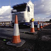 HGV negotiating traffic management at road works. United Kingdom.