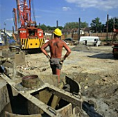 Construction worker bare chest during a hot day