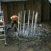 Breaking out reinforced concrete using pneumatic drills.