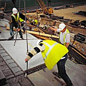 Installation of pre-fabricated concrete roofpanels during construction of Imperial War Museum, Duxford