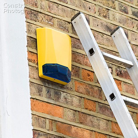 Burglar alarm fitted to house low angle