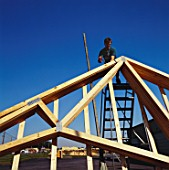 Carpenter working on timber roof structure
