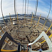 Looking down from crane positioning roof support during construction of the Millennium Dome, Greenwich, London, UK