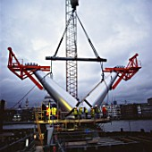 Installation of pre-fabricated arms during construction of the Millennium Bridge, London, UK