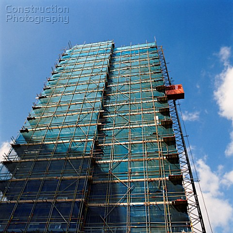 Scaffolding erected over full height of tower block