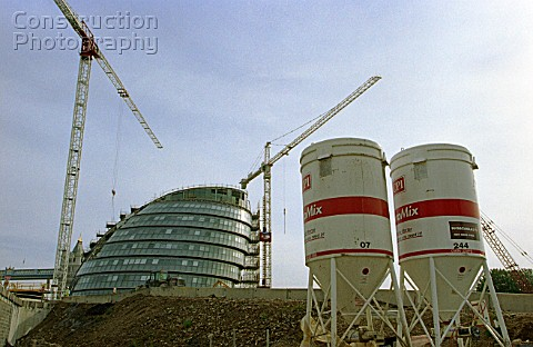 On site concrete batching plant Cement Silo on a building site In the background City Hall Greater L