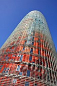 The 144 meters Torre Agbar tower in Barcelona, Spain, designed by French architect Jean Nouvel 2004. Main contractor Dragados. Developer: Layetana. The building has a multi-coloured skin inspired by Antoni Gaudi with cladding panels made of 40 different colours.