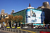 Large advertising hoarding covering a building under refurbishment, La Rambla, Barcelona, Spain