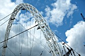 The Wembley Stadium triumphant arch is the main focus of this £757 M project. The steel arch weighing 1,650 tonnes will support a 7,000-tonne retractable roof. Within a span of 315m-high, the Wembley arch will be the longest single-span roof structure in the world.