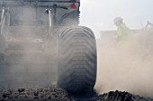 View of large truck and dust during roadwork operations, UK.