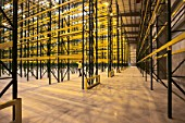 Empty warehouse with shelving and racks
