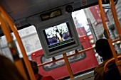 CCTV screen on double decker bus, London, UK