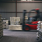 Fork Lift Truck moving materials in metal warehouse, Holland.