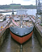 Cargo ship undergoing refit in dry dock. Falmouth, Cornwall, United Kingdom