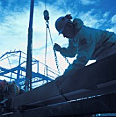 A construction worker handling steel framework.