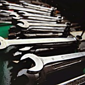 A variety of spanners in a workshop.