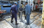 Oil workers on drilling floor of a drilling rig in the Caspian Sea, Azerbaijan