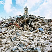 Pile of rubble in front of clock tower
