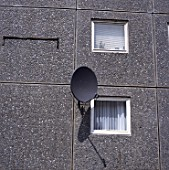 Satellite dish on the facade of a 1970s council tower block, Islington, London
