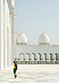 An immigrant worker returns from afternoon prayers during the final stages of construction of the Sheik Zayed Mosque, Abu Dhabi.