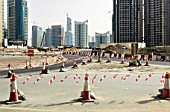 Temporary traffic cone routing with towers under construction, Dubai Marina. Dubai