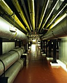 Barbican, London. View of the Engine and Plant Room packed with large pipes and boilers, below the Art Centre.