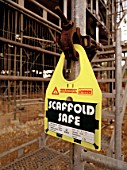 Safety sign attached on a scaffold