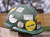 Worn hard hat covered in stickers.