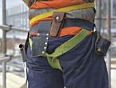 Safety belt. Harness is a mandatory safety equipment for scaffolders