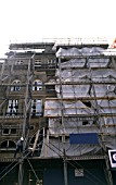 Scaffolding covering the facade of a period building during restoration.
