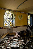 Demolition of old house with stained galss window
