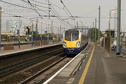 Commuter train apporching a station UK