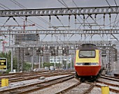 Commuter train apporching a station, UK.