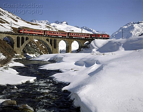 Local Train in Winter Scenery Track of the Glacier Express  Swiss Alps  Canton of Uri  Switzerland