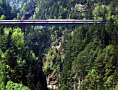Intercity train on Saint Gotthard railway track - bridge (near the village of Wassen) - Swiss Alps - canton of Uri - Switzerland
