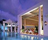 Swimming pool and dining room of hotel Sandals at evening - island of Saint Lucia - archipelago of the Lesser Antilles - Caribbean