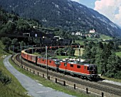 Freight train on Saint Gotthard railway track, Swiss Alps, Canton of Uri, Switzerland