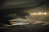 Aircraft after take off, airport at night