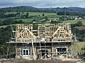 Cardiff, Cefn Mably. Luxury housing development in 12 acres of parkland by regional developer Meadgate Homes overlooking countryside. Showhome under construction in parkland setting with rural countryside beyond.  Shell building with roof trusses nearing completion